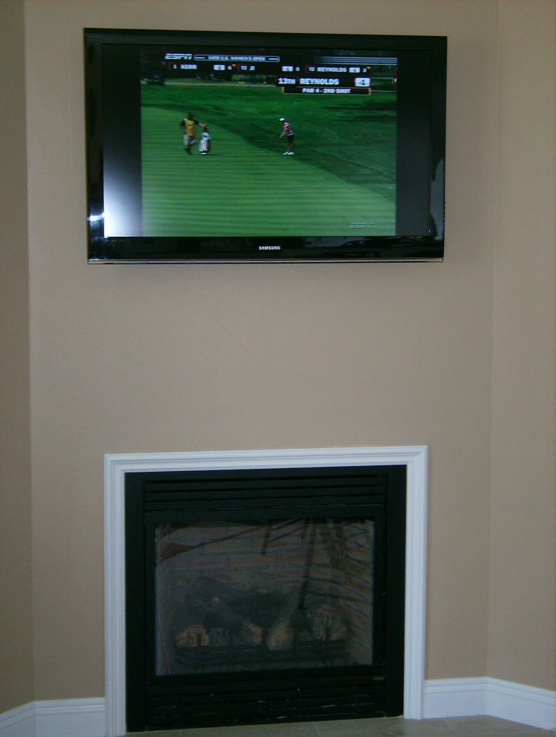 Premium LCD TV Mounted Over Fireplace