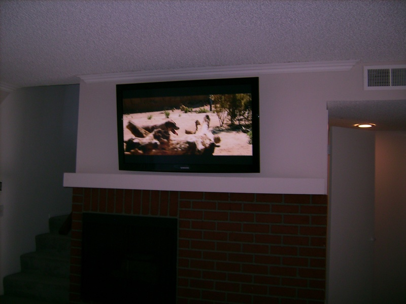 Toshiba Plasma TV Mounted Over Fireplace