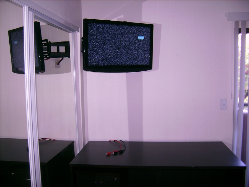 Premium Corner TV Installation over closet mirror door