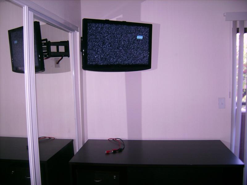 Premium Corner TV Installation over closet mirror door