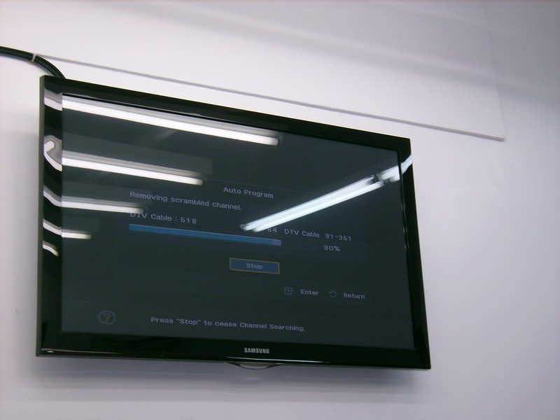 Standard TV Installation over doorway in car dealership