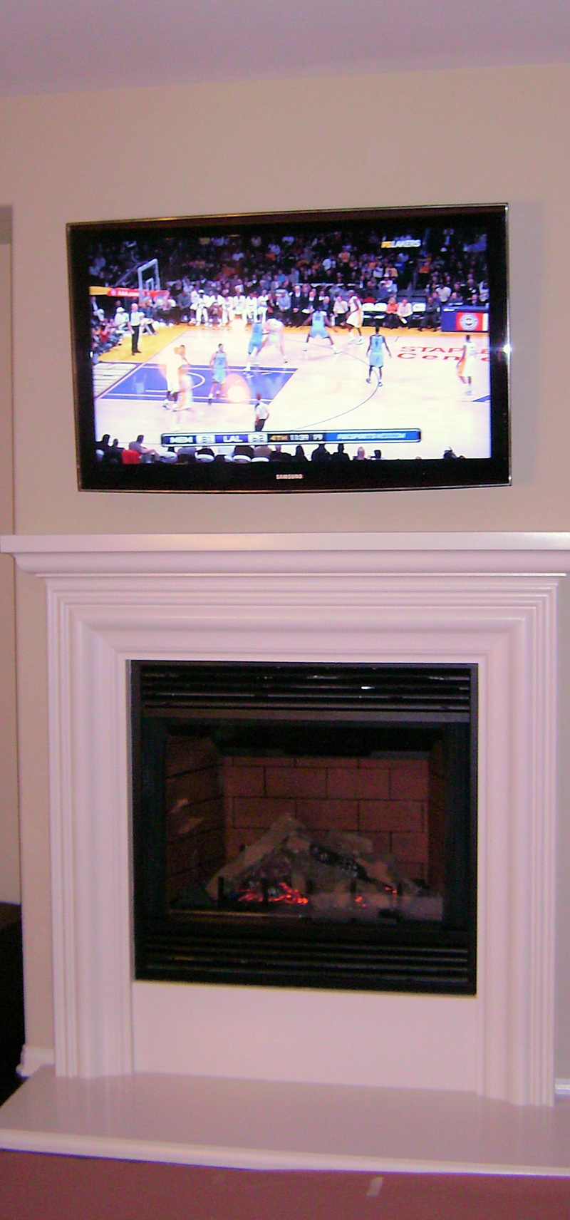 Samsung Tv Mounted over gas fireplace