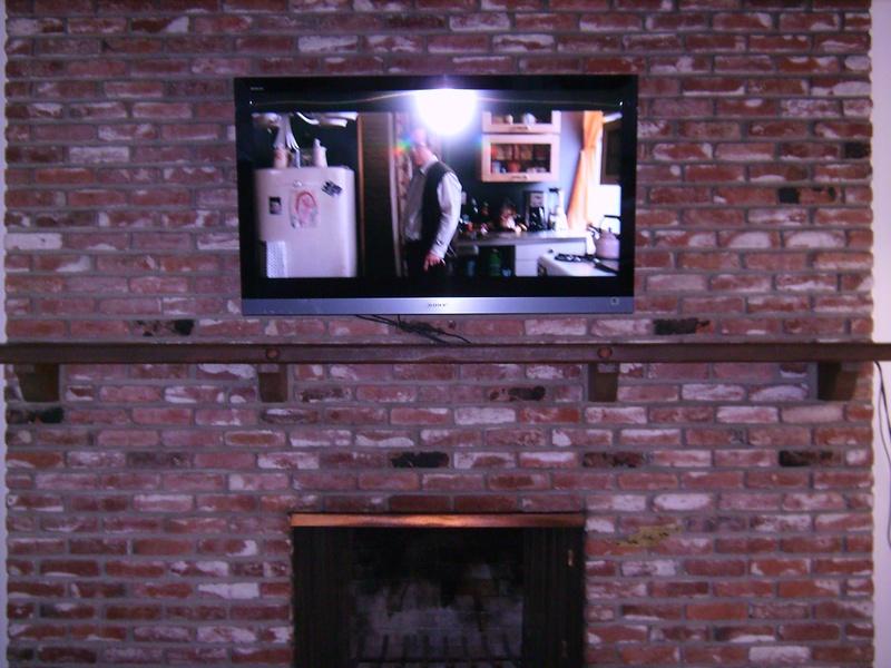 "52"" Sony Bravia Plasma Mounted over brick fireplace"
