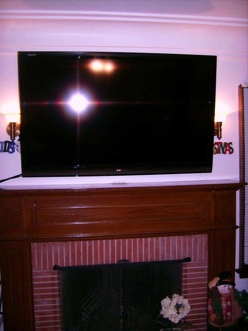 "57"" Sharp Plasma Mounted over Fireplace Standard Installation"