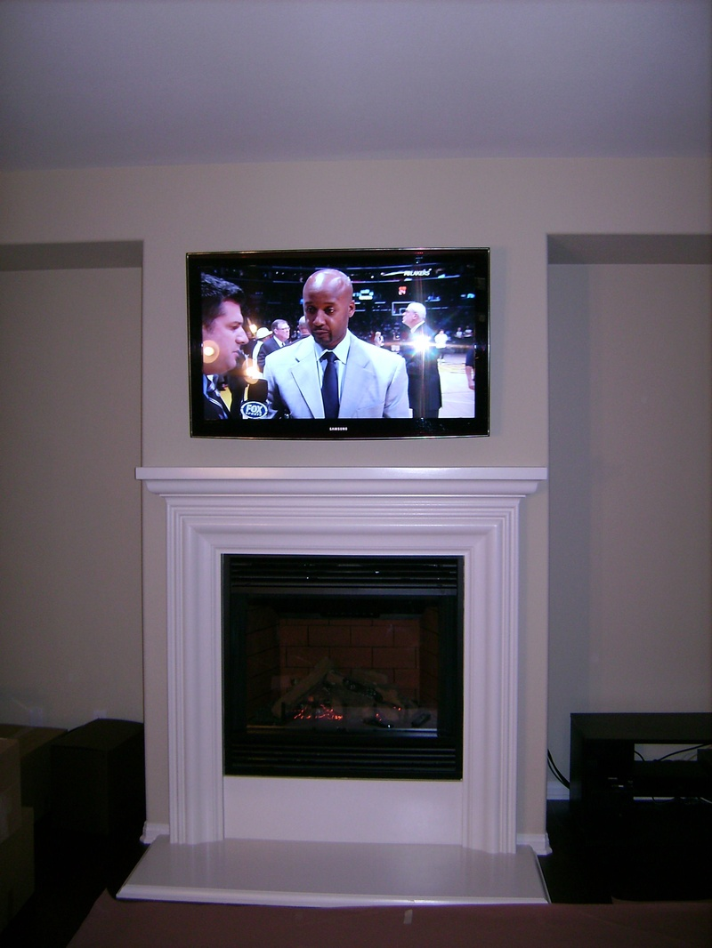 Samsung Plasma TV Mounted over Fireplace with Concealed Wires