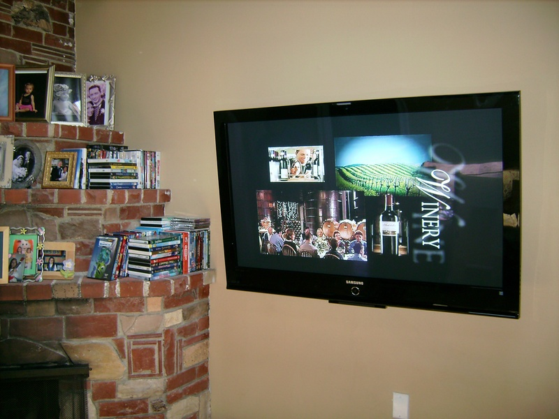 Premium TV Installation Next to Fireplace