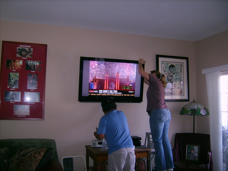 Applying finishing touches to Samsung TV installation